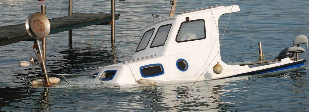 Picture of boat capsizing after an accident